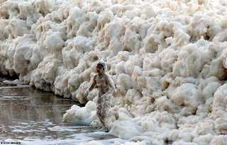 Boy Emerging from Foam on Australian Beach