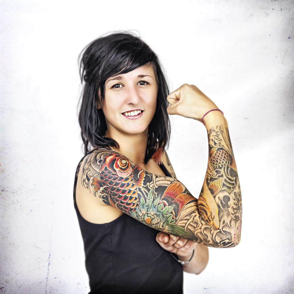 Beautiful Woman with Arm Tattoos