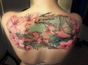 Woman with Bird Tattoo Across Back