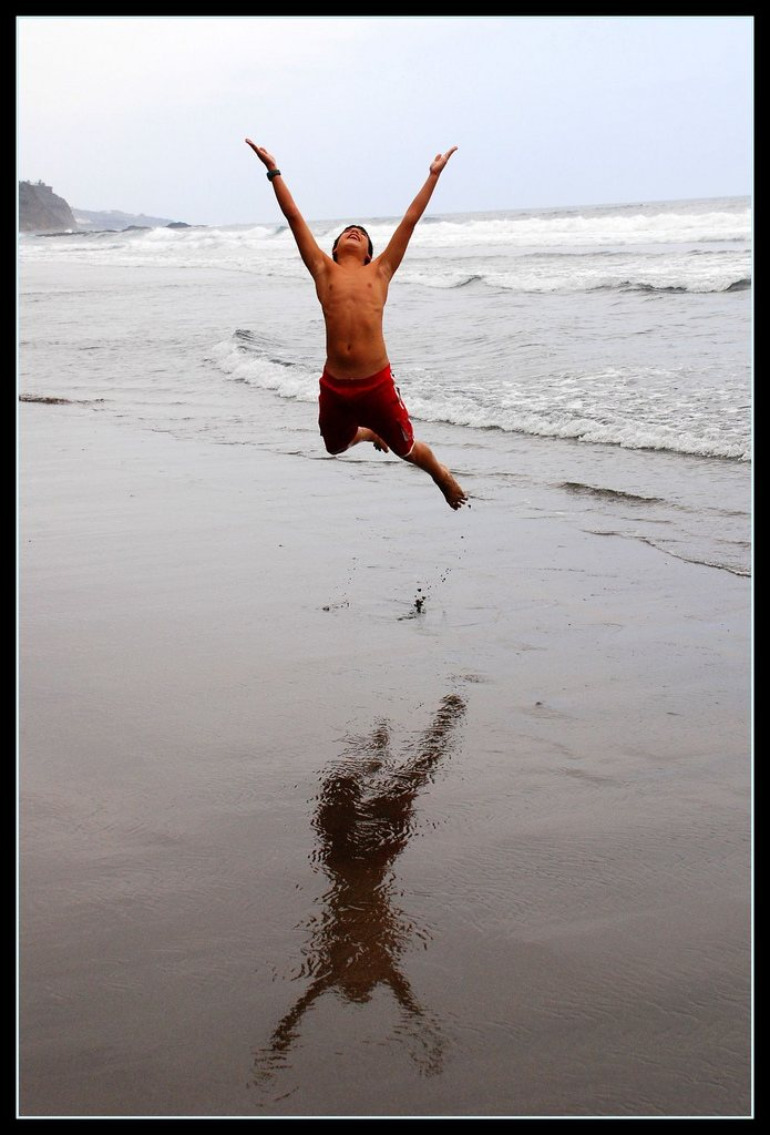 Boy Jumping on Beach
