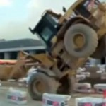 Think You Can Drive? This Guy Can Wheelie an Excavator!